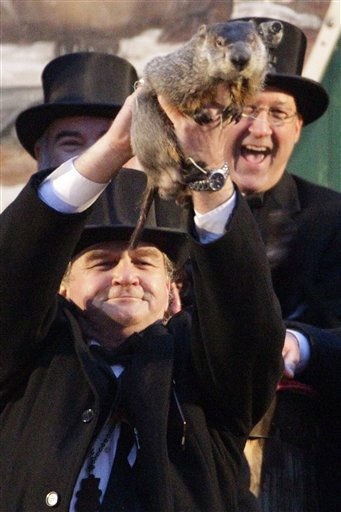 "<div class=""meta ""><span class=""caption-text "">Groundhog Club handler John Griffiths, left, holds Punxsutawney Phil, the weather prognosticating groundhog, during the 126th celebration of Groundhog Day on Gobbler's Knob in Punxsutawney, Pa. Thursday, Feb. 2, 2012. Phil saw his shadow, forecasting six more weeks of winter weather.   (AP Photo/ Gene J. Puskar)</span></div>"