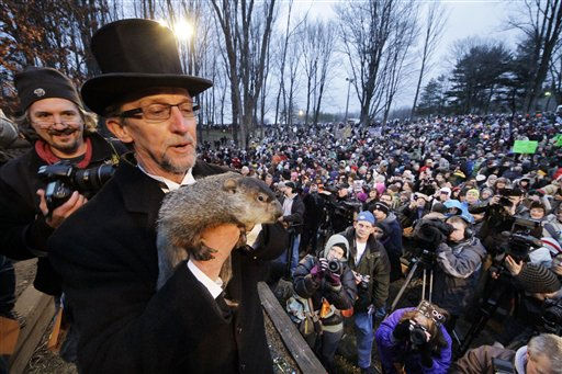 "<div class=""meta ""><span class=""caption-text "">Groundhog Club handler Ron Ploucha holds Punxsutawney Phil, the weather prognosticating groundhog, during the 126th celebration of Groundhog Day on Gobbler's Knob in Punxsutawney, Pa. Thursday, Feb. 2, 2012. Phil saw his shadow, forecasting six more weeks of winter weather.  (AP Photo/ Gene J. Puskar)</span></div>"