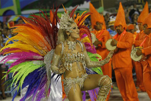 Drum queen Antonia Fontenelle, from Mocidade Independente de Padre Miguel samba school, dances during carnival parade at the Sambadrome in Rio de Janeiro, Brazil, Monday, Feb.20, 2012. Millions watched the sequin-clad samba dancers at Rio de Janeiro&#39;s iconic Carnival parade.  &#40;AP Photo&#47;Silvia Izquierdo&#41; <span class=meta>(AP Photo&#47; Silvia Izquierdo)</span>