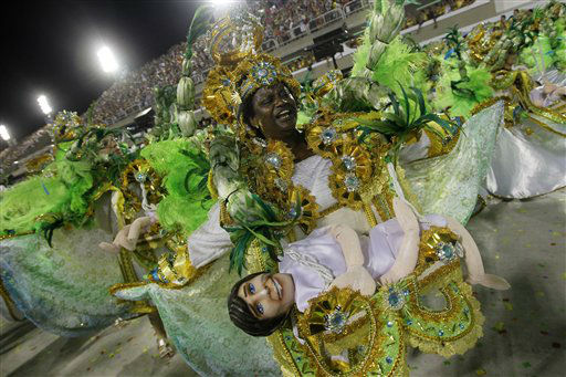 Performers from the Mocidade Independente de Padre Miguel samba school parade during carnival celebrations at the Sambadrome in Rio de Janeiro, Brazil, Monday, Feb. 20, 2012. Millions watched the sequin-clad samba dancers at Rio de Janeiro&#39;s iconic Carnival parade.  &#40;AP Photo&#47;Silvia Izquierdo&#41; <span class=meta>(AP Photo&#47; Silvia Izquierdo)</span>