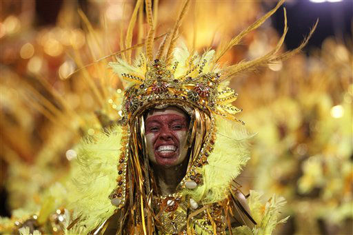 A performer from the Beija Flor samba school parades during carnival celebrations at the Sambadrome in Rio de Janeiro, Brazil, Monday, Feb. 20, 2012.  Millions watched the sequin-clad samba dancers at Rio de Janeiro&#39;s iconic Carnival parade.  &#40;AP Photo&#47;Silvia Izquierdo&#41; <span class=meta>(AP Photo&#47; Silvia Izquierdo)</span>