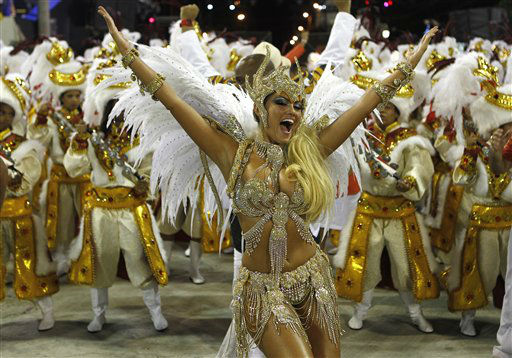 Performers from the Beija Flor samba school parade during carnival celebrations at the Sambadrome in Rio de Janeiro, Brazil, Monday, Feb. 20, 2012. Millions watched the sequin-clad samba dancers at Rio de Janeiro&#39;s iconic Carnival parade.&#40;AP Photo&#47;Victor R. Caivano&#41; <span class=meta>(AP Photo&#47; Victor R. Caivano)</span>