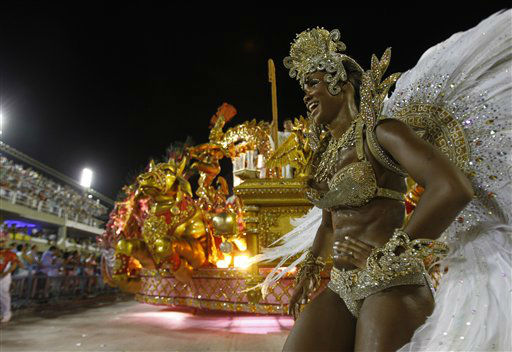 A performer from the Beija Flor samba school parades during carnival celebrations at the Sambadrome in Rio de Janeiro, Brazil, Monday, Feb. 20, 2012.  Millions watched the sequin-clad samba dancers at Rio de Janeiro&#39;s iconic Carnival parade. &#40;AP Photo&#47;Victor Caivano&#41; <span class=meta>(AP Photo&#47; Victor R. Caivano)</span>