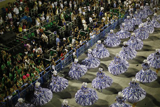 Dancers of Beija Flor samba school parade during carnival celebrations at the Sambadrome in Rio de Janeiro, Brazil, Monday Feb.  20, 2012. Millions watched the sequin-clad samba dancers at Rio de Janeiro&#39;s iconic Carnival parade.&#40;AP Photo&#47;Felipe Dana&#41; <span class=meta>(AP Photo&#47; Felipe Dana)</span>