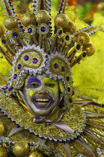 Millions watched the sequin-clad samba dancers at Rio de Janeiro&#39;s iconic Carnival parade.  A performer from the Beija Flor samba school parades during carnival celebrations at the Sambadrome in Rio de Janeiro, Brazil, Monday, Feb. 20, 2012.  Millions watched the sequin-clad samba dancers at Rio de Janeiro&#39;s iconic Carnival parade. &#40;AP Photo&#47;Victor R. Caivano&#41; <span class=meta>(AP Photo&#47; Victor R. Caivano)</span>