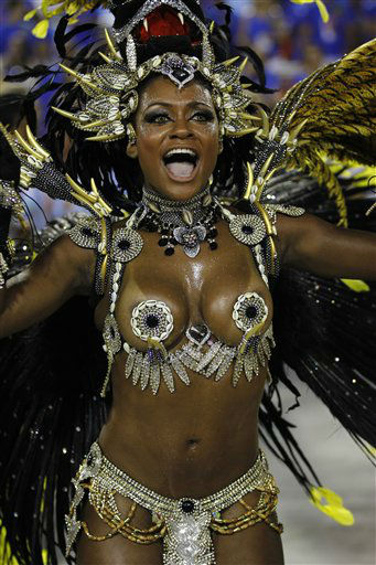 A performer from the Beija Flor samba school parades during carnival celebrations at the Sambadrome in Rio de Janeiro, Brazil, Monday, Feb. 20, 2012.  Millions watched the sequin-clad samba dancers at Rio de Janeiro&#39;s iconic Carnival parade.  &#40;AP Photo&#47;Victor R. Caivano&#41; <span class=meta>(AP Photo&#47; Victor R. Caivano)</span>
