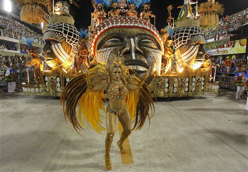 Performers from the Unidos da Vila Isabel samba school parade during carnival celebrations at the Sambadrome in Rio de Janeiro, Brazil, Monday, Feb.20, 2012. Millions watched the sequin-clad samba dancers at Rio de Janeiro&#39;s iconic Carnival parade.  &#40;AP Photo&#47;Victor R. Caivano&#41; <span class=meta>(AP Photo&#47; Victor R. Caivano)</span>