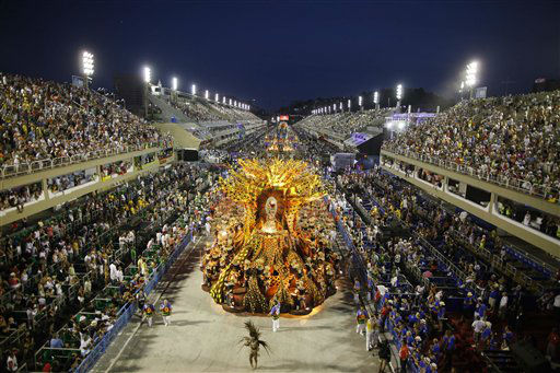 Dancers of Vila Isabel samba school parade on a float during carnival celebrations at the Sambadrome in Rio de Janeiro, Brazil, Monday Feb.  20, 2012.  Millions watched the sequin-clad samba dancers at Rio de Janeiro&#39;s iconic Carnival parade.  &#40;AP Photo&#47;Felipe Dana&#41; <span class=meta>(AP Photo&#47; Felipe Dana)</span>