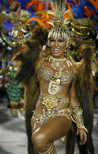 Sabrina Sato, Queen of Vila Isabel samba school, parades at the Sambadrome during carnival celebrations in Rio de Janeiro, Brazil, Monday, Feb. 20, 2012.  Millions watched the sequin-clad samba dancers at Rio de Janeiro&#39;s iconic Carnival parade.   &#40;AP Photo&#47;Victor R. Caivano&#41; <span class=meta>(AP Photo&#47; Victor R. Caivano)</span>