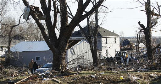 Residents walk the streets the morning after severe storms destroyed several homes and businesses in Harveyville, Kan., Wednesday, Feb. 29, 2012.   <span class=meta>(AP Photo&#47; Orlin Wagner)</span>
