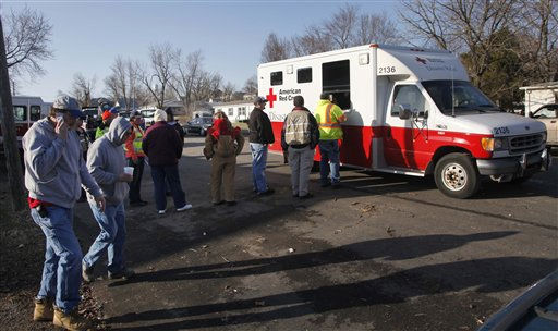 Residents and volunteers line up for food and drink, the morning after severe storms destroyed several homes and businesses in Harveyville, Kan., Wednesday, Feb. 29, 2012.  <span class=meta>(AP Photo&#47; Orlin Wagner)</span>