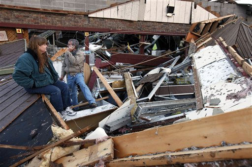 Sherry Cousins and her brother Bruce Wallace of Hollister, Mo., sit in the wreckage of their secondhand store in Branson, Mo, Wednesday, Feb. 29, 2012. A powerful storm system that produced multiple reports of tornadoes lashed the Midwest early Wednesday, roughing up the country music resort city of Branson.   <span class=meta>(AP Photo&#47; Mark Schiefelbein)</span>