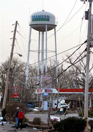 A gas station is damaged and power lines are down in Branson, Mo, Wednesday, Feb.  29, 2012.  A powerful storm system  lashed the Midwest early Wednesday, roughing up the country music resort city of Branson and laying waste to a small town in Kansas.   <span class=meta>(AP Photo&#47; Mark Schiefelbein)</span>