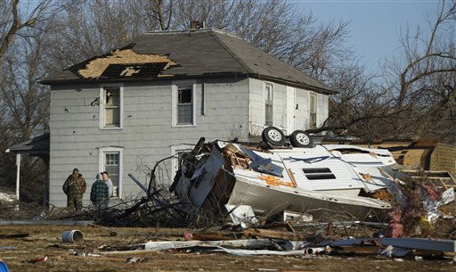 Residents gather the morning after severe storms destroyed several homes and businesses in Harveyville, Kan., Wednesday, Feb. 29, 2012.  <span class=meta>(AP Photo&#47; Orlin Wagner)</span>