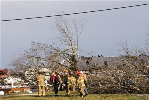 Clean-up crews survey the tornado damage to homes Friday, March 2, 2012 in Marysville, Ind. Powerful storms stretching from the U.S. Gulf Coast to the Great Lakes in the north wrecked two small towns, killed at least three people and bred anxiety across a wide swath of the country on Friday, in the second deadly tornado outbreak this week. &#40;AP Photo&#47;Brian Bohannon&#41; <span class=meta>(AP Photo&#47; Brian Bohannon)</span>