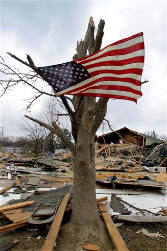 An American flag flies from what is left of the tree in front of a destroyed senior center Friday, March 2, 2012, in Harrisburg, Ill.   A pre-dawn twister flattened entire blocks of homes Wednesday as violent storms ravaged the Midwest and South.  &#40;AP Photo&#47;Seth Perlman&#41; <span class=meta>(AP Photo&#47; Seth Perlman)</span>