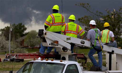 Charter cable workers keep a close eye on an approaching storm as sirens sound signaling a possible tornado on Friday, March. 2, 2012, in Athens, Ala. Powerful storms stretching from the U.S. Gulf Coast to the Great Lakes in the north wrecked two small towns, killed at least three people and bred anxiety across a wide swath of the country in the second deadly tornado outbreak this week. &#40;AP Photo&#47;Butch Dill&#41; <span class=meta>(AP Photo&#47; Butch Dill)</span>