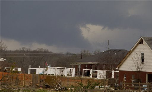 "<div class=""meta ""><span class=""caption-text "">Threatening storm clouds approach areas already damaged by an earlier tornado on Friday, March. 2, 2012, in Athens, Ala. Powerful storms stretching from the U.S. Gulf Coast to the Great Lakes in the north wrecked two small towns, killed at least three people and bred anxiety across a wide swath of the country on Friday, in the second deadly tornado outbreak this week. (AP Photo/Butch Dill) (AP Photo/ Butch Dill)</span></div>"