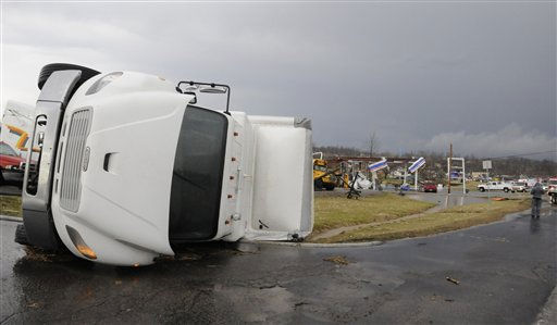 "<div class=""meta ""><span class=""caption-text "">A semitrailer lies on its side in front of the remains of a gas station following severe storms Friday, March 2, 2012, in Henryville, Ind.  Tornadoes ripped across several small southern Indiana towns on Friday, killing at least three people and leaving behind miles of flattened devastation along the border with Kentucky.  (AP Photo/Timothy D. Easley) (AP Photo/ Timothy D. Easley)</span></div>"
