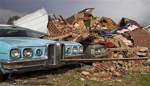 "<div class=""meta ""><span class=""caption-text "">A tornado left a path of destruction as it passed through Friday, March 2, 2012, in Athens, Ala. Powerful storms stretching from the Gulf Coast to the Great Lakes flattened buildings in several states, wrecked two Indiana towns and bred anxiety across a wide swath of the country in the second powerful tornado outbreak this week.  (AP Photo/Butch Dill) (AP Photo/ Butch Dill)</span></div>"