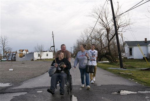 Residents of Marysville, Ind., survey the tornado damage to their homes Friday, March 2, 2012 in Marysville, Ind. Powerful storms stretching from the U.S. Gulf Coast to the Great Lakes in the north wrecked two small towns, killed at least three people and bred anxiety across a wide swath of the country on Friday, in the second deadly tornado outbreak this week. &#40;AP Photo&#47;Brian Bohannon&#41; <span class=meta>(AP Photo&#47; BRIAN BOHANNON)</span>