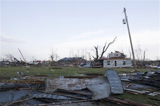 "<div class=""meta ""><span class=""caption-text "">Residents of Marysville, Ind., survey the tornado damage to their homes Friday, March 2, 2012 in Marysville. Powerful storms stretching from the U.S. Gulf Coast to the Great Lakes in the north wrecked two small towns, killed at least three people and bred anxiety across a wide swath of the country on Friday, in the second deadly tornado outbreak this week. (AP Photo/Brian Bohannon) (AP Photo/ Brian Bohannon)</span></div>"