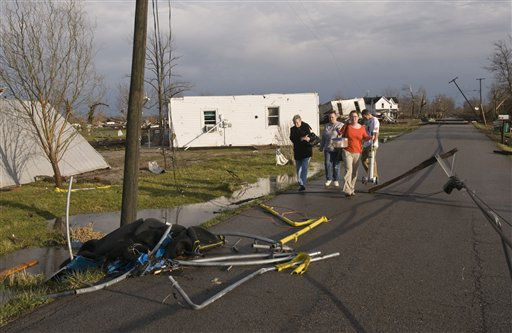 Residents of Marysville, Ind., survey the tornado damage to their homes Friday, March 2, 2012 in Marysville. Powerful storms stretching from the U.S. Gulf Coast to the Great Lakes in the north wrecked two small towns, killed at least three people and bred anxiety across a wide swath of the country on Friday, in the second deadly tornado outbreak this week. &#40;AP Photo&#47;Brian Bohannon&#41; <span class=meta>(AP Photo&#47; Brian Bohannon)</span>