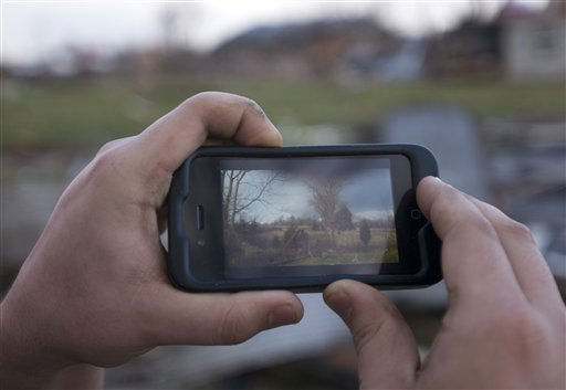 Acosta Medrano shows a video of the tornado that hit Marysville, Ind., Friday, March 2, 2012, on his iPhone in Marysville. Powerful storms stretching from the U.S. Gulf Coast to the Great Lakes in the north wrecked two small towns, killed at least three people and bred anxiety across a wide swath of the country on Friday, in the second deadly tornado outbreak this week. &#40;AP Photo&#47;Brian Bohannon&#41; <span class=meta>(AP Photo&#47; Brian Bohannon)</span>