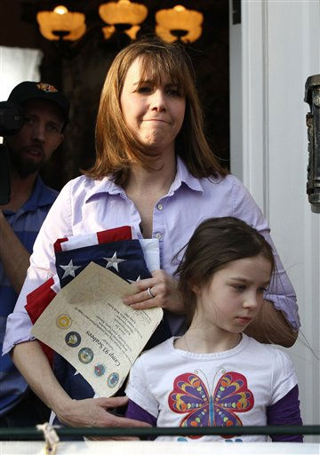Patti Blagojevich, left, stands with her daughter Annie, as former Illinois Gov. Rod Blagojevich signs autographs after  his scheduled statement to reporters and his eventual departure for a medium-security facility in Littleton, Colo., for his 14-year sentence on corruption charges, that include his attempt to sell President Barack Obama&#39;s former Senate seat. Wednesday, March 14, 2012, in Chicago. &#40;AP Photo&#47;Charles Rex Arbogast&#41; <span class=meta>(AP Photo&#47; Charles Rex Arbogast)</span>