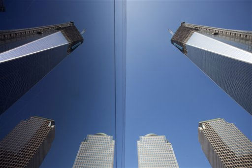 One World Trade Center, top right, and nearby buildings, lower right, are reflected in the glass facade, left, of the National September 11 Museum, Monday, March 19, 2012 in New York. The tower, now up to the 93rd floor, is expected to be completed in late 2013. &#40;AP Photo&#47;Mark Lennihan&#41; <span class=meta>(AP Photo&#47; Mark Lennihan)</span>