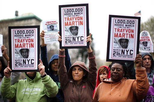 "<div class=""meta image-caption""><div class=""origin-logo origin-image ""><span></span></div><span class=""caption-text"">Demonstrators hold up signs during a rally for Trayvon Martin, Wednesday, March 21, 2012, in New York. A few hundred people are marching in New York City in memory of Trayvon Martin, a black teenager shot to death by a Hispanic neighborhood watch captain in Florida. The teenager was unarmed and was wearing a hoodie.   (AP Photo/ John Minchillo)</span></div>"