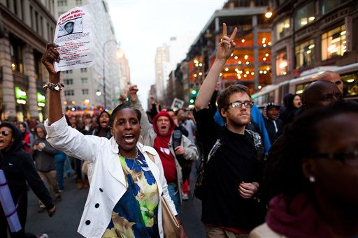 "<div class=""meta ""><span class=""caption-text "">Demonstrators march after a rally for Trayvon Martin, an unarmed teenager who was shot dead in Florida by a neighborhood watch member, Wednesday, March 21, 2012, in New York. Martin's parents told people at the march in his memory that they won?t stop until they get justice for him. He was killed Feb. 26 returning to a gated community in Sanford, Fla., after buying candy at a convenience store. He was unarmed and was wearing a hooded sweat shirt, called a hoodie.   (AP Photo/ John Minchillo)</span></div>"