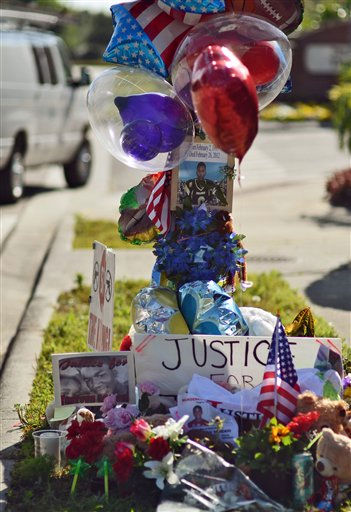A memorial for Trayvon Martin sits on display outside The Retreat at Twin Lakes neighborhood in Sanford, Fla., Friday, March 23, 2012. Martin was slain in the town of Sanford, Fla., on Feb. 26 in a shooting that has set off a nationwide furor over race and justice. Neighborhood crime-watch captain George Zimmerman claimed self-defense and has not been arrested, though state and federal authorities are still investigating. Since the slaying, a portrait has emerged of Martin as a laid-back young man who loved sports, was extremely close to his father, liked to crack jokes with friends and, according to a lawyer for his family, had never been in trouble with the law.   <span class=meta>(AP Photo&#47; Roberto Gonzalez)</span>