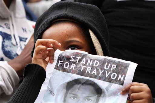 Wearing a hooded sweatshirt, or hoodie, Zafia Slaughter, 5, of Washington, holds a sign saying &#34;Stand Up For Trayvon,&#34; at a rally with her mother and siblings to demand justice for Trayvon Martin at Freedom Plaza in Washington, Saturday, March 24, 2012. Martin, an unarmed young black teen was fatally shot by a volunteer neighborhood watchman.   <span class=meta>(AP Photo&#47; Jacquelyn Martin)</span>