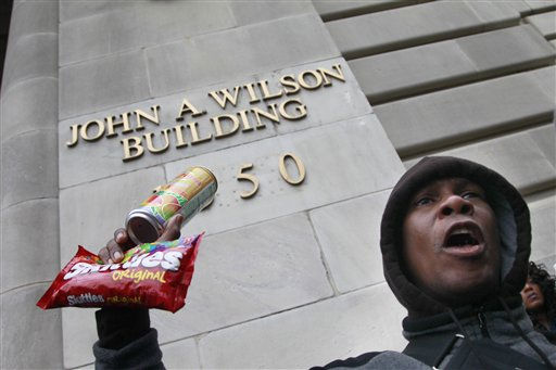 An unidentifed man holds a can of tea and a bag of Skittles at a rally demanding justice for Trayvon Martin in Freedom Plaza, Saturday, March 24, 2012, in Washington. Martin, an unarmed young black teen was fatally shot by a volunteer neighborhood watchman.   <span class=meta>(AP Photo&#47; Haraz N. Ghanbari)</span>