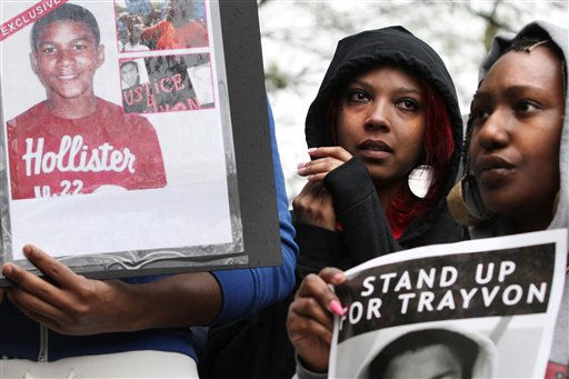 A woman wipes away tears next to a photograph of Trayvon Martin during a rally in support of the slain teenager at Freedom Plaza in Washington, on Saturday, March 24, 2012. Martin, an unarmed young black teen, was fatally shot by a volunteer neighborhood watchman.   <span class=meta>(AP Photo&#47; Jacquelyn Martin)</span>