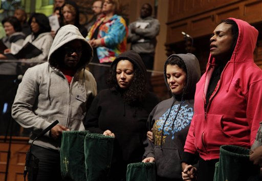 Senior Minister Jacqueline Lewis, right, prays with other congregants during a service at Middle Collegiate Church in New York, Sunday, March 25, 2012. Church-goers were invited to wear hoodies to services to show their support for justice in the case of Trayvon Martin, an unarmed black teenager who was wearing a hoodie on the night he was killed by a neighborhood watch captain in Florida.   <span class=meta>(AP Photo&#47; Seth Wenig)</span>