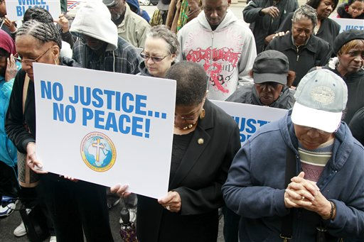 People pray during a rally held by The Missionary Baptist Ministers&#39; Conference of  Washington, D.C. and Vicinity in honor of Trayvon Martin, Sunday, March 25, 2012, in front of the Department of Justice in Washington.  <span class=meta>(AP Photo&#47; Haraz N. Ghanbari)</span>