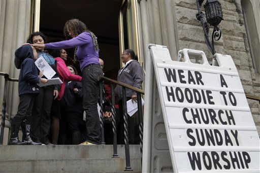 "<div class=""meta image-caption""><div class=""origin-logo origin-image ""><span></span></div><span class=""caption-text"">Congregants arrive at Middle Collegiate Church in New York, Sunday, March 25, 2012. Church-goers were invited to wear hoodies to services to show their support for justice in the case of Trayvon Martin, an unarmed black teenager who was wearing a hoodie on the night he was killed by a neighborhood watch captain in Florida.   (AP Photo/ Seth Wenig)</span></div>"