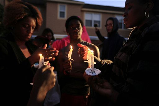 "<div class=""meta image-caption""><div class=""origin-logo origin-image ""><span></span></div><span class=""caption-text"">Attendees light candles for a vigil at the Retreat at Twin Lakes, near where Trayvon Martin was shot by neighborhood watch captain George Zimmerman, in Sanford, Fla., Sunday, March 25, 2012.  (AP Photo/ Julie Fletcher)</span></div>"