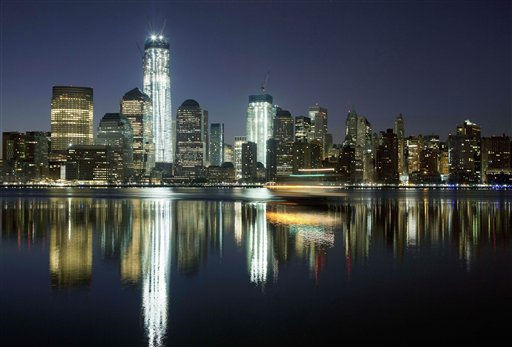 "<div class=""meta image-caption""><div class=""origin-logo origin-image ""><span></span></div><span class=""caption-text"">FILE - In this March 26, 2012, file photo, One World Trade Center towers above the Lower Manhattan skyline and Hudson River in New York. One World Trade Center, the giant monolith being built to replace the twin towers destroyed in the Sept. 11 attacks, will lay claim to the title of New York City?s tallest skyscraper on Monday, April 30 as workers erect steel columns that will make its unfinished skeleton a little over 1,250 feet, just high enough to peak over the observation deck on the Empire State Building. The milestone is a preliminary one. The so-called ?Freedom Tower? isn?t expected to reach its full height for at least another year, at which point it is likely to be declared the tallest building in the U.S.  (AP Photo/Mark Lennihan, File) (AP Photo/ Mark Lennihan)</span></div>"