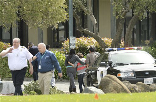 "<div class=""meta image-caption""><div class=""origin-logo origin-image ""><span></span></div><span class=""caption-text"">An unidentified group leaves Oikos University after a school shooting in Oakland, Calif., Monday, April 2, 2012. A suspect was detained Monday in a shooting attack at a California Christian university. (AP Photo/Noah Berger) (AP Photo/ Noah Berger)</span></div>"