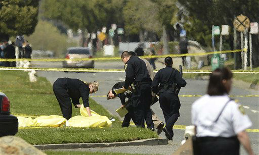 Oakland Police cover bodies near Oikos University in Oakland, Calif., Monday, April 2, 2012. A gunman opened fire at Oikos University in California Monday, killing at least five people, law enforcement sources close to the investigation said. Police say they have a suspect in custody. &#40;AP Photo&#47;Noah Berger&#41; <span class=meta>(AP Photo&#47; Noah Berger)</span>