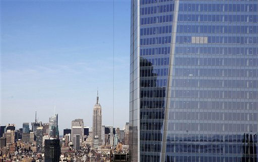 "<div class=""meta ""><span class=""caption-text "">FILE - In this April 17, 2012, file photo, One World Trade Center, right, rises above the  Manhattan skyline and the Empire State Building, center, in New York. One World Trade Center, the giant monolith being built to replace the twin towers destroyed in the Sept. 11 attacks, will lay claim to the title of New York City?s tallest skyscraper on Monday, April 30 as workers erect steel columns that will make its unfinished skeleton a little over 1,250 feet, just high enough to peak over the observation deck on the Empire State Building, center. The milestone is a preliminary one. The so-called ?Freedom Tower? isn?t expected to reach its full height for at least another year, at which point it is likely to be declared the tallest building in the U.S.  (AP Photo/Mark Lennihan, File) (AP Photo/ Mark Lennihan)</span></div>"