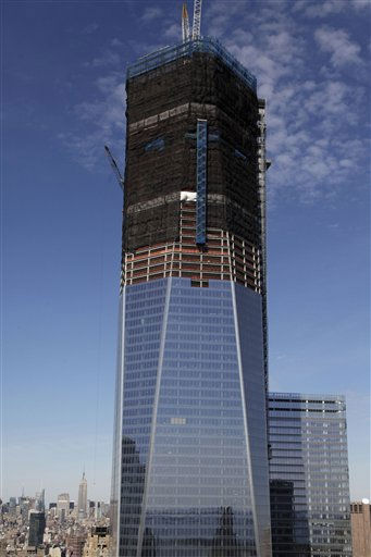 "<div class=""meta ""><span class=""caption-text "">FILE- In this April 17, 2012, file photo, One World Trade Center, now up to 100 floors, rises above the  Manhattan skyline in New York. On Monday, April 30, One World Trade Center _ being built to replace the twin towers destroyed on 9/11 _ gets steel columns to make its unfinished framework a little higher than the Empire State Building's observation deck, to become the tallest building in New York. (AP Photo/Mark Lennihan) (AP Photo/ Mark Lennihan)</span></div>"
