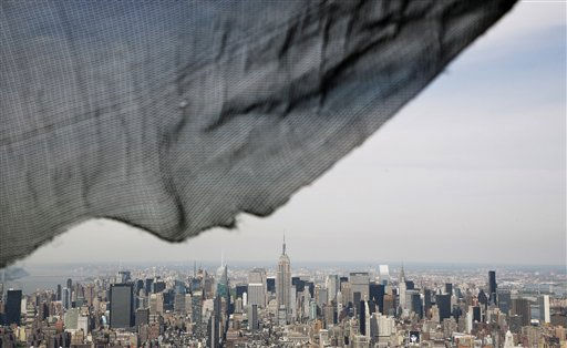 A torn safety net on One World Trade Center provides a window view of the Manhattan skyline, Monday, April 30, 2012 in New York. One World Trade Center is being built to replace the twin towers destroyed in the Sept. 11 attacks. It reached just over 1,250 feet on Monday. That&#39;s just taller than the observation deck on the Empire State Building. &#40;AP Photo&#47;Mark Lennihan, Pool&#41; <span class=meta>(AP Photo&#47; Mark Lennihan)</span>