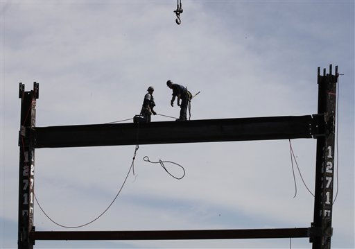 Ironworkers Jim Brady, left, and Billy Geoghan release a steel cable after connecting a steel beam between two columns at the top of One World Trade Center to make it New York City&#39;s tallest skyscraper, Monday, April 30, 2012 in New York. One World Trade Center is being built to replace the twin towers destroyed in the Sept. 11 attacks. It reached just over 1,250 feet on Monday. That&#39;s just taller than the observation deck on the Empire State Building. &#40;AP Photo&#47;Pool, Mark Lennihan&#41; <span class=meta>(AP Photo&#47; Mark Lennihan)</span>