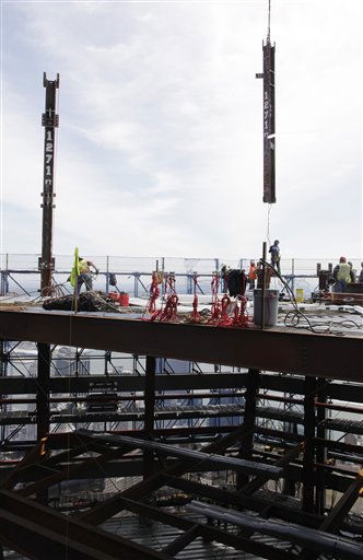Ironworkers connect the second of two columns at the top of One World Trade Center to make it New York City&#39;s tallest skyscraper, Monday, April 30, 2012 in New York. One World Trade Center is being built to replace the twin towers destroyed in the Sept. 11 attacks. It reached just over 1,250 feet on Monday. That&#39;s just taller than the observation deck on the Empire State Building. &#40;AP Photo&#47;Pool, Mark Lennihan&#41; <span class=meta>(AP Photo&#47; Mark Lennihan)</span>