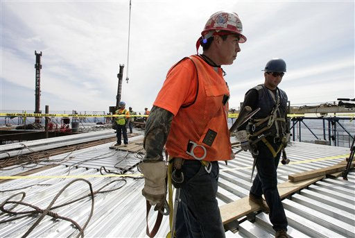 "<div class=""meta ""><span class=""caption-text "">Ironworkers Adam Cross, left, and Steven Cross walk across the top deck of the World Trade center after connecting two steel columns, left, to make the tower New York City's tallest skyscraper, Monday, April 30, 2012 in New York. The cousins are from the Kahnawae native american reservation in Quebec, Canada. One World Trade Center is being built to replace the twin towers destroyed in the Sept. 11 attacks. It reached just over 1,250 feet on Monday. That's just taller than the observation deck on the Empire State Building. (AP Photo/Mark Lennihan, Pool) (AP Photo/ Mark Lennihan)</span></div>"