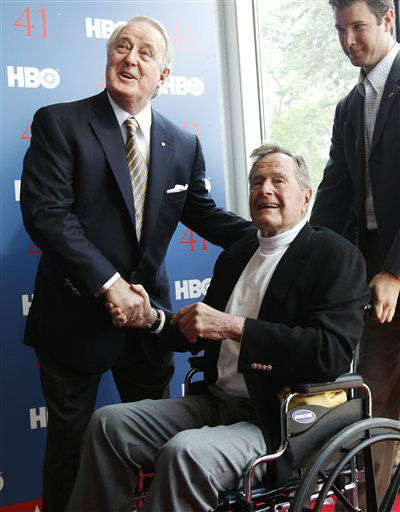 President George H.W. Bush, right, shakes hands with former Canadian Prime Minister Brian Mulroney as they arrive for the premiere of HBO&#39;s new documentary on the president&#39;s  life near the family compound in Kennebunkport, Maine, Tuesday, June 12, 2012.  The premiere was held on the president&#39;s 88th birthday.  <span class=meta>(AP Photo&#47; Charles Krupa)</span>